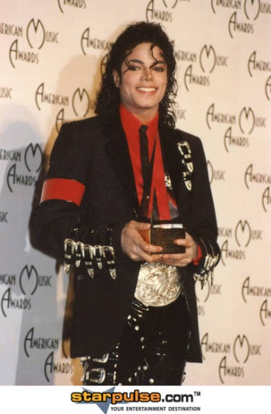 Michael Jackson with one of many awards in his career.