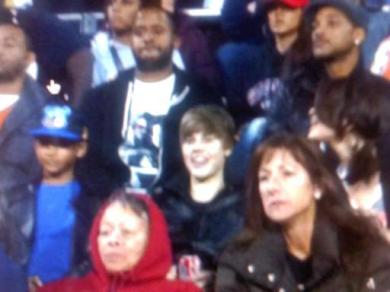 Justin Bieber with Selena Gomez to the right of him (side shot of Selena)