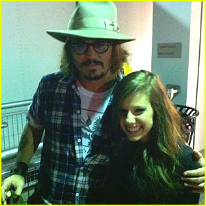 Johnny Depp With Avery At Justin Bieber's Concert